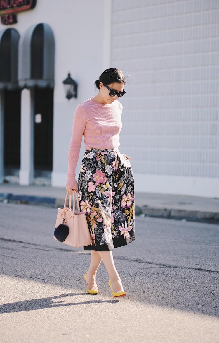 Feminine In Pink Style, Summer Knit Wear, Floral Midi Skirt, Prada Bag, Pom Pom Key Chain, Christian Louboutin So Kate, via: HallieDaily